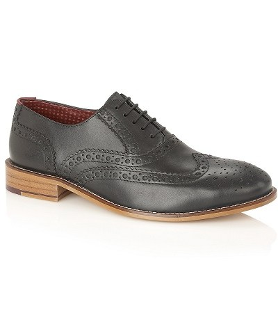 Black brogues with tan sole