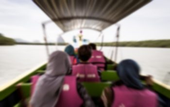 Blurred refugees on a boat