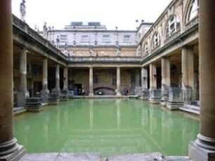 Image of rectangular pool of greenish water at the Roman Baths in Bath, England
