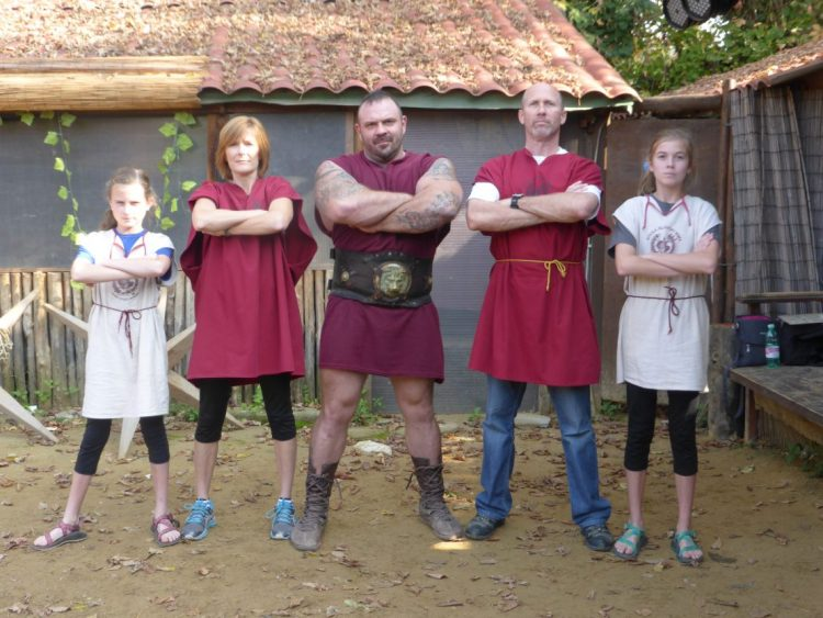 Family stands with Gladiator after lessons