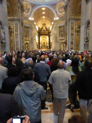 Huge crowd of people inside St. Peter's Basilica