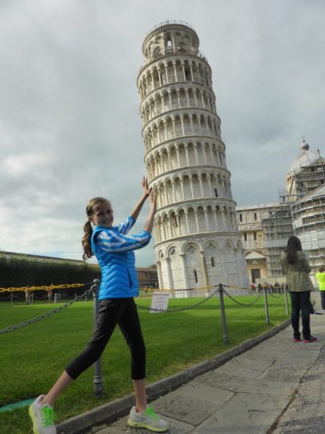 Girl posing like she's supporting the Leaning Tower