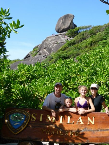 Family stands behind Similan Thailand sign