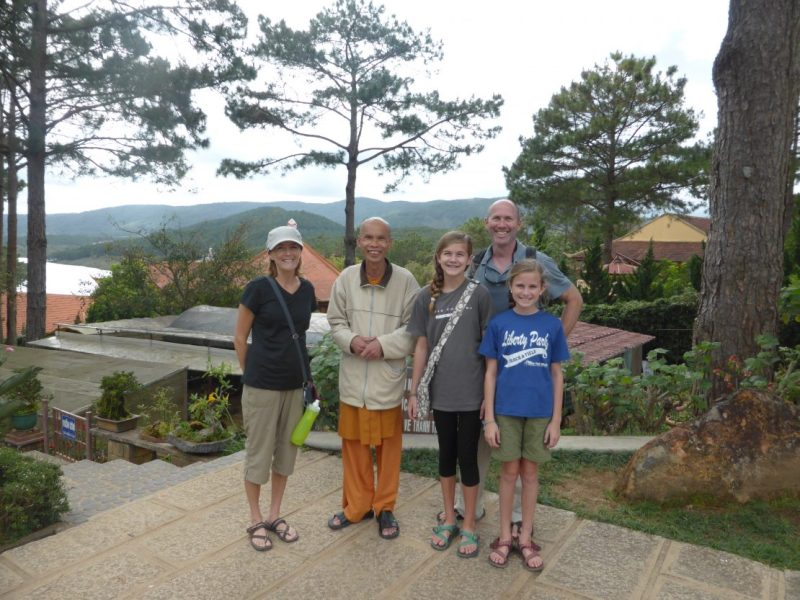 Family with Buddhist monk at Truc Lam