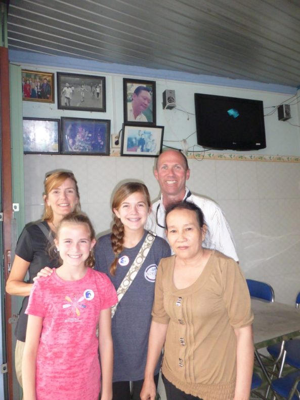 Standing in Kim Phuc's family's restaurant with her sister-in-law.