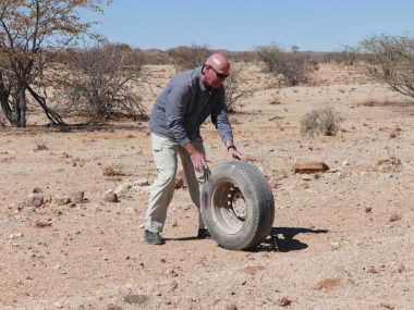 Rolling tire in Namibia desert