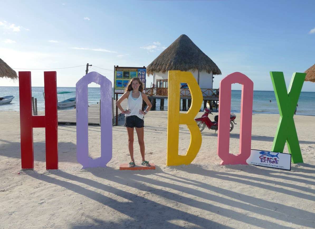 "Life sized Holbox Island sign on the beach. The space for the ""L"" is blank so visitors can stand in its place for photo ops."