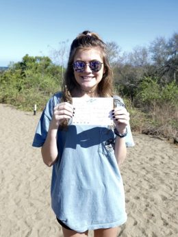 Girl holding postcard to deliver at Post Office Bay