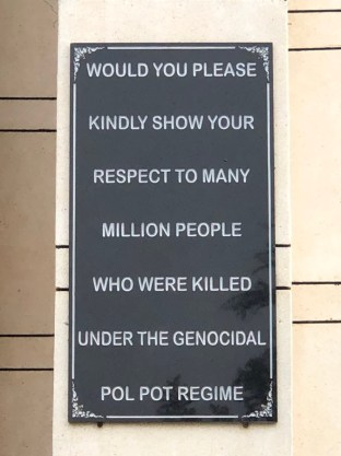 Killing Fields memorial sign: would you please kindly show your respect to the many million people who were killed under the genocidal pol pot regime