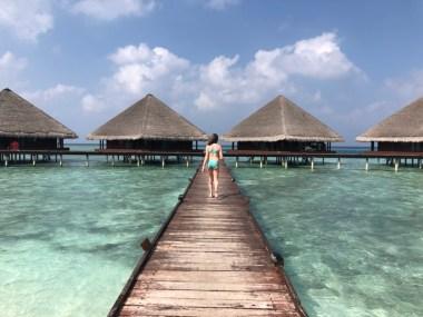 Boardwalk to overwater bunglows Maldives