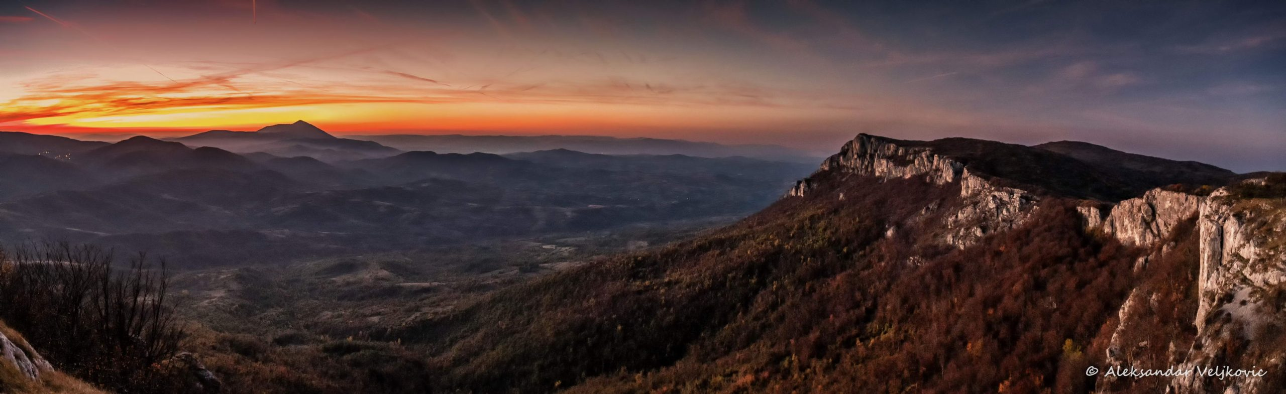 The stone wall of Tupižnica and distant Rtanj together at sunset