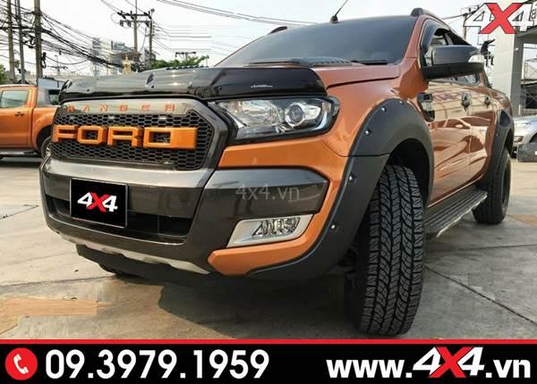 Chiếc bán tải Ford Ranger màu cam độ ốp lướt gió capo Ranger màu đen cực ngầu và chất