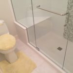 Custom glass shower door and surround installation. We can provide custom glass installation for your tile shower.