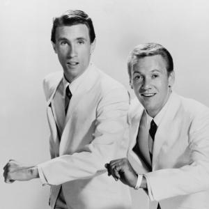 The Righteous Brothers in white suits. Bill Medley on left, Bobby Hatfield on right.