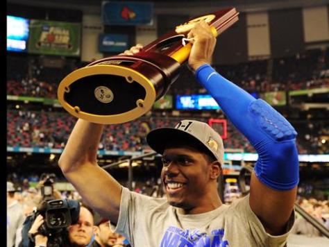 Kentucky forward Terrence Jones hoists the NCAA championship trophy