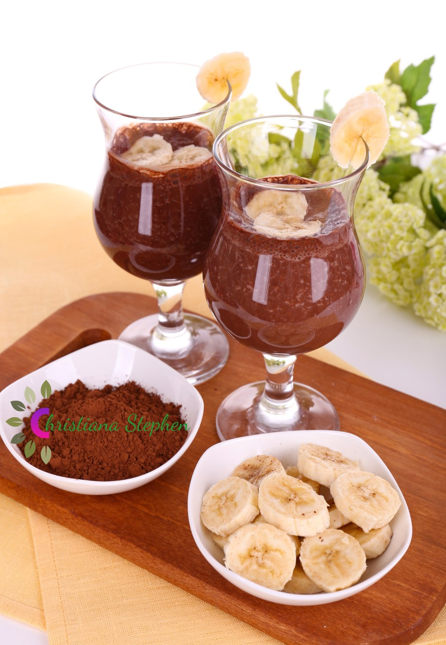 Cocktails with banana and chocolate on table on white background