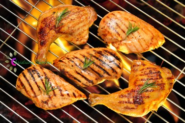 Grilled chicken breast and chicken thigh on the flaming grill