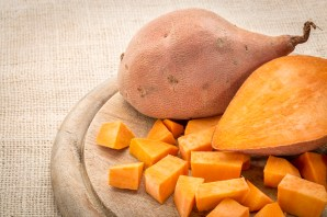sweet potato cut and diced on a cutting board