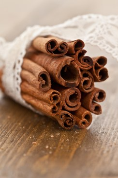 Cinnamon sticks roll in a bundle with a lace ribbons