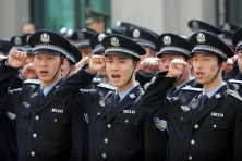 SHENYANG, CHINA - MAY 04: (CHINA OUT) Police officers salute their national flag as China celebrates Youth Day on May 4, 2011 in Shenyang, Liaoning Province of China. The Youth Day in China falls on May 4 every year to commemorate the beginning of the May Fourth Movement (1919). (Photo by ChinaFotoPress/Getty Images)