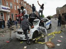 riots_baltimore-2015-dance-on-car