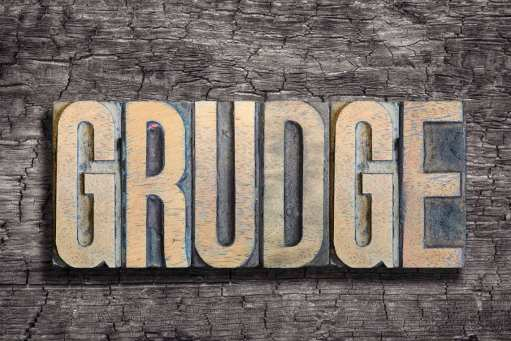 grudge word made from vintage letterpress type on burned wood