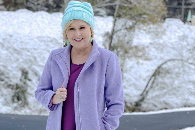 A blue beanie and a purple coat