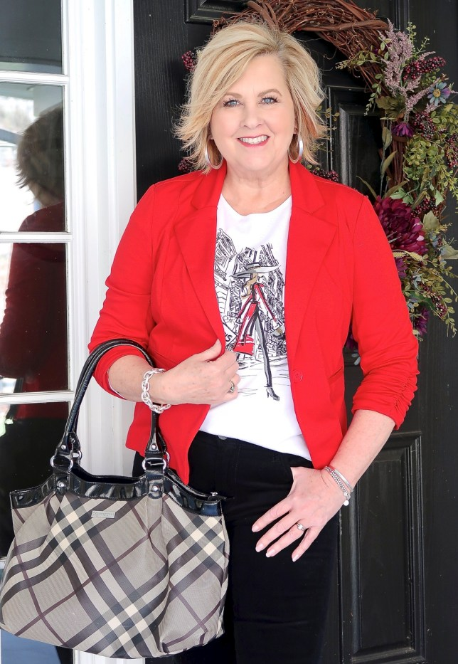 Fashion Blogger 50 Is Not Old looks stylish in a red jacket and a graphic tee