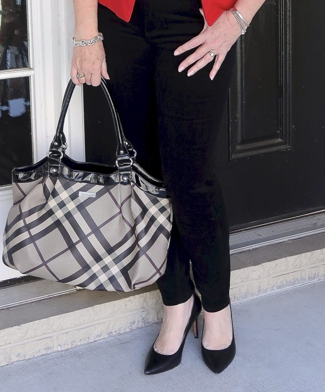 Fashion Blogger 50 Is Not Old looks stylish in a wearing black velvet pants and black pumps