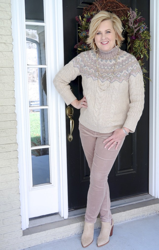 Fashion Blogger 50 Is Not Old styling a monochromatic look with a beige sweater and pants