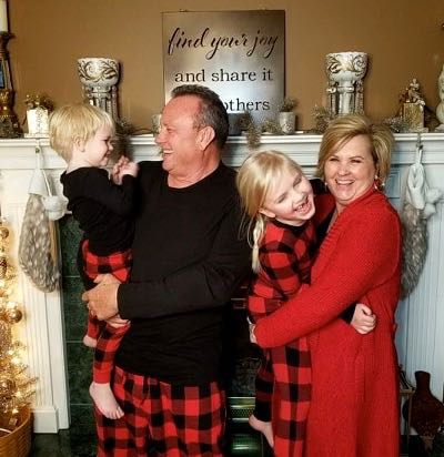 Fashion blogger 50 is not old and husband in pajamas with grandchildren