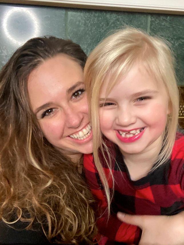 two smiling girls in pajamas