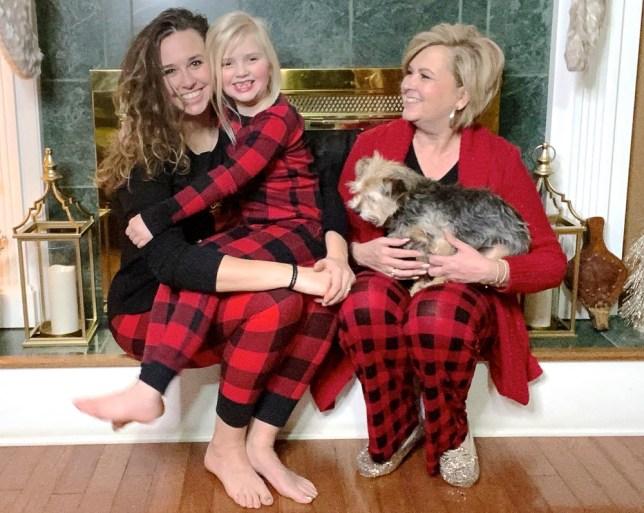 GRANDMOTHER, DAUGHTER, AND GRANDDAUGHTER IN PAJAMAS