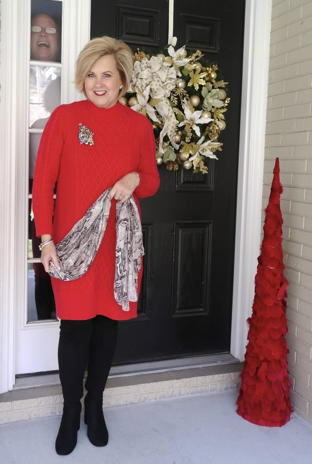 Fashion Blogger 50 is not old wearing a red sweater dress and black boots