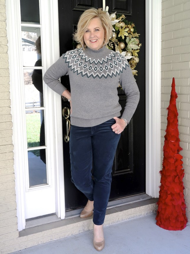 Fashion Blogger 50 Is Not Old wearing a gray Fairisle sweater and teal corduroy pants