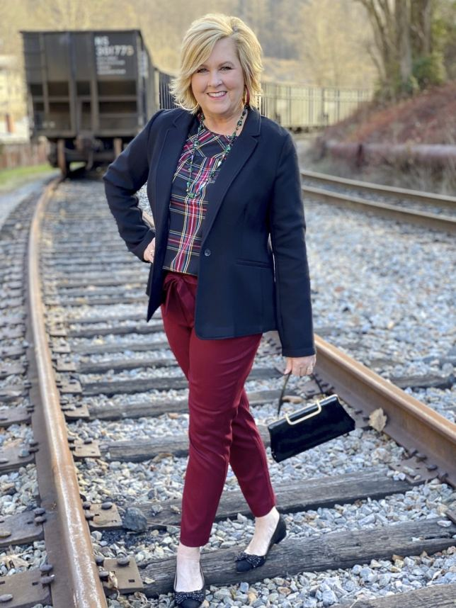 Black blazer and burgundy ankle pants worn by Fashion Blogger 50 Is Not Old