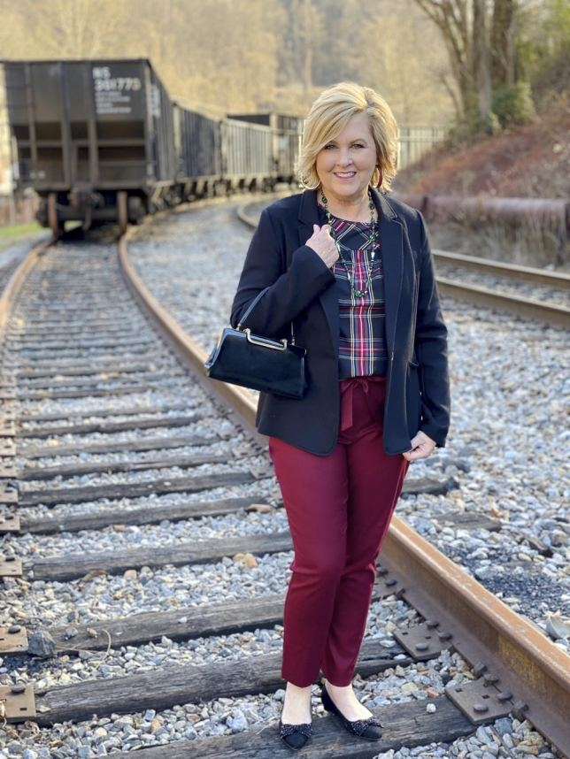 Black blazer, a plaid top, and burgundy ankle pants worn by Fashion Blogger 50 Is Not Old