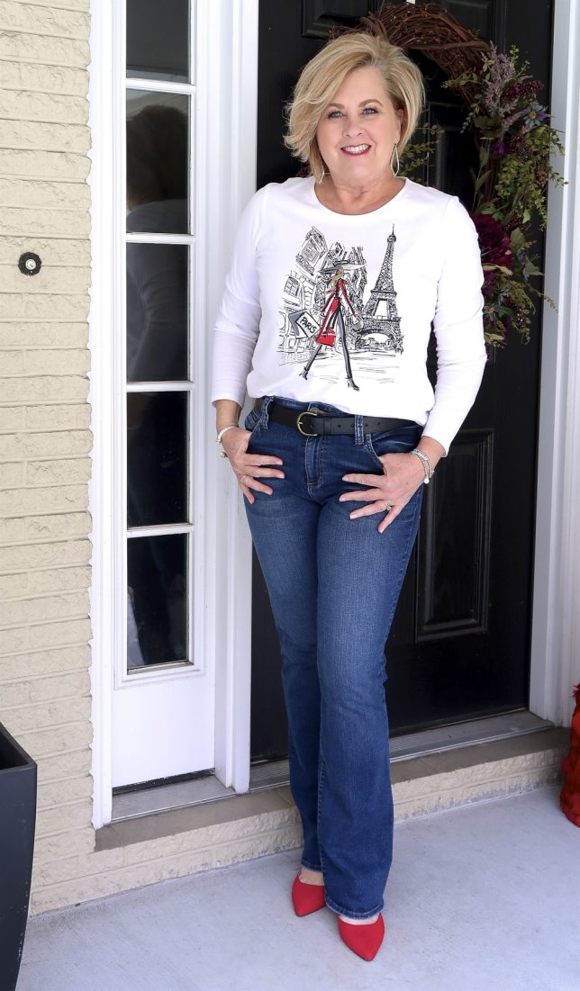 FASHION BLOGGER 50 Is Not Old styles a graphic Paris tee with jeans and red bow mules