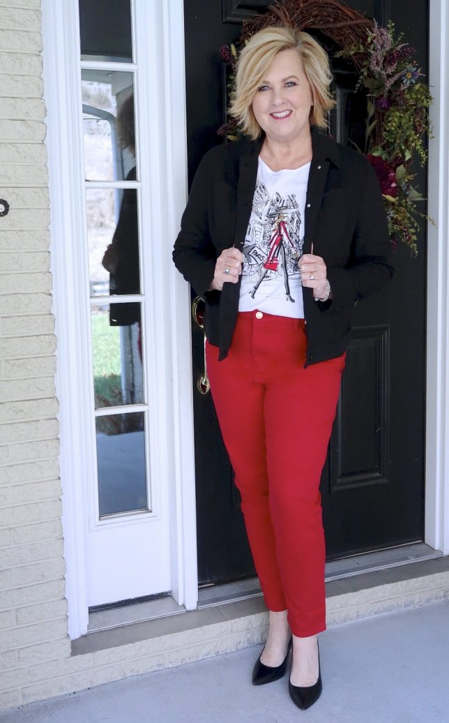 FASHION BLOGGER 50 IS NOT OLD IS WEARING A BLACK DENIM JACKET AND RED PANTS FROM CHICO'S WITH BLACK PUMPS FROM COACH