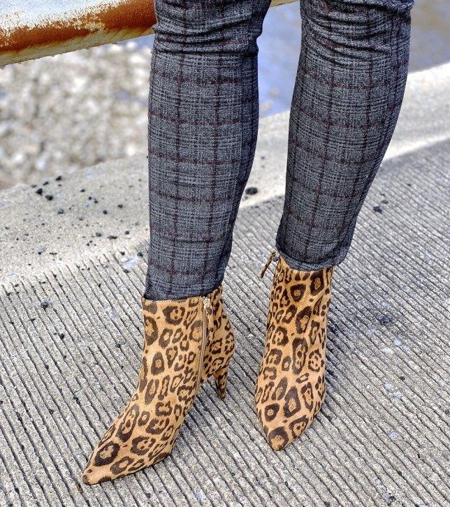 50 Is Not Old blogger wearing animal print boots.