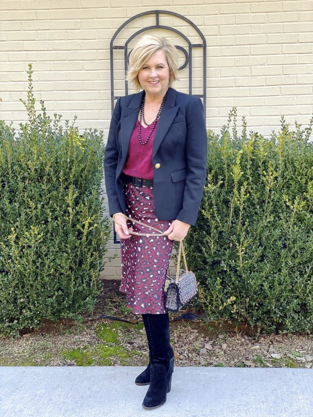 Office wear by fashion blogger 50 is not old. Leopard print skirt and black knee boots
