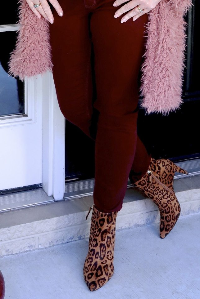 Fashion Blogger 50 Is Not Old is wearing burgundy pants and animal print booties.