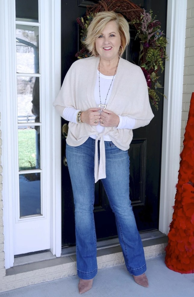 Casual style from Fashion Blogger 50 Is Not Old in flare jeans and a neutral tie-front cardigan from Chico's with pointy boots