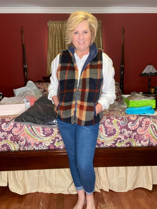 Plaid fuzzy vest that is reversible and jeans