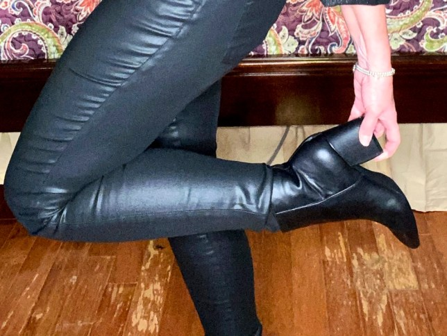 Black coated jeans and black boots worn by fashion blogger 50 Is Not Old