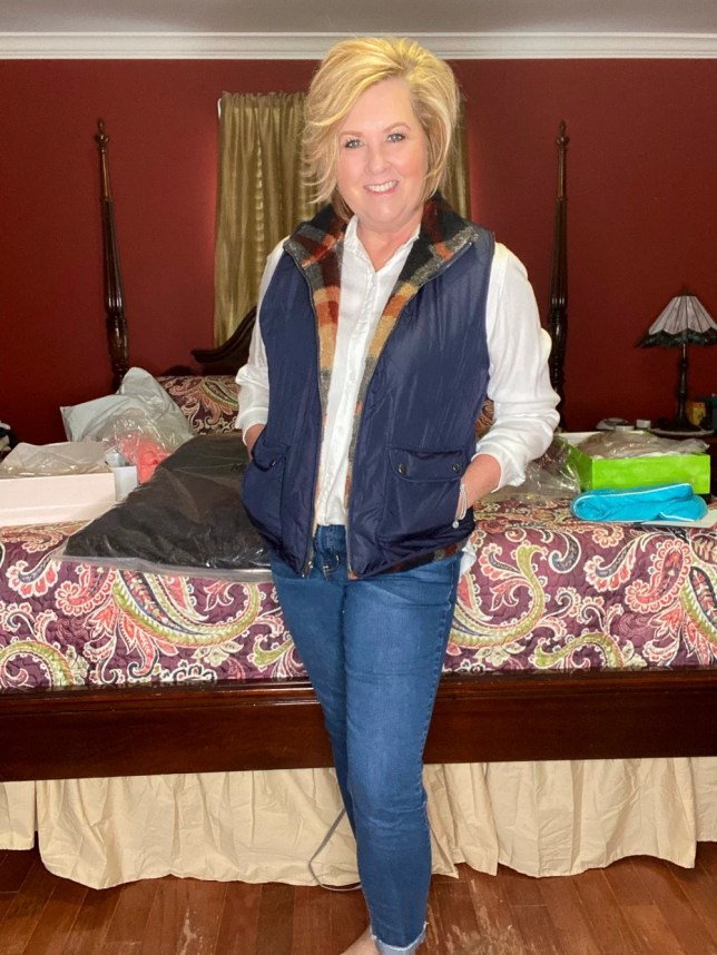 Navy Vest with plaid lining and jeans