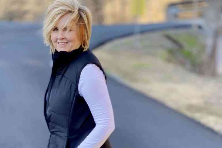 Fashion Blogger 50 Is Not Old wearing a black quilted vest from Walmart
