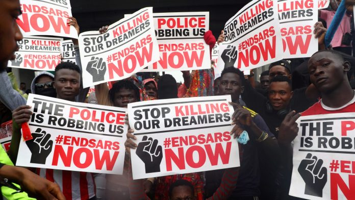 dear nigerian youths, forget #endsars and fight other battles - 2020 10 15T110316Z 55760605 RC2ZIJ9IKQCE RTRMADP 3 NIGERIA PROTESTS POLICE scaled e1602932474521 - Dear Nigerian youths, forget #endSARS and fight other battles