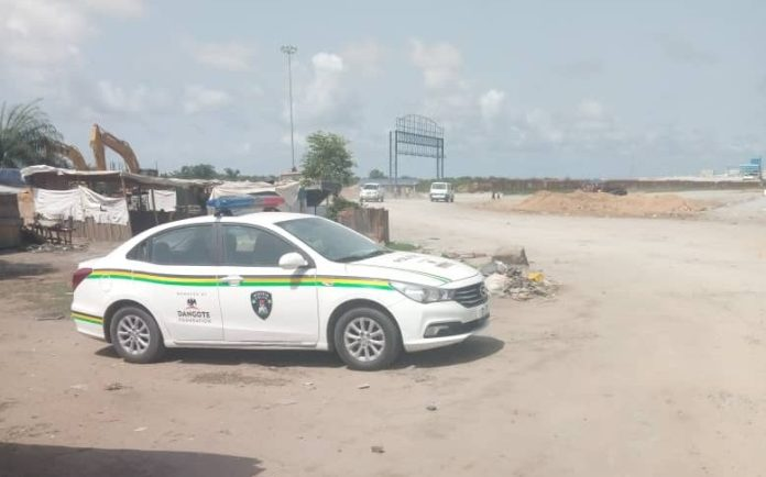 Dangote Refinery: Police Allegedly Shot Protesting Worker dangote refinery - Police van stationed near the site e1590478242526 - Dangote Refinery: Police Allegedly Shot Protesting Worker