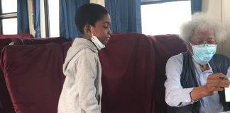 Happy Dad Shares Moment Professor Wole Soyinka Signed an Autograph for His Son On a Lagos-Abeokuta Train Ride